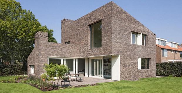 La casa in laterizio che rivisita la tradizione olandese for Piani di casa con vista sull acqua