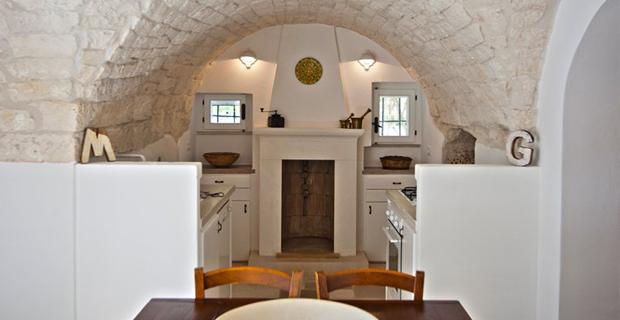 Arco Cucina Soggiorno: Soggiorno con mezza separazione cucina more divisori per ambienti.